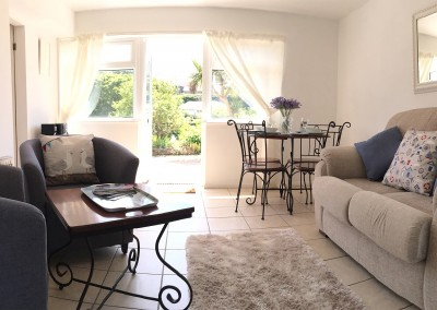 Bright, sunny living room and diner with double aspect windows looking out to front and rear gardens